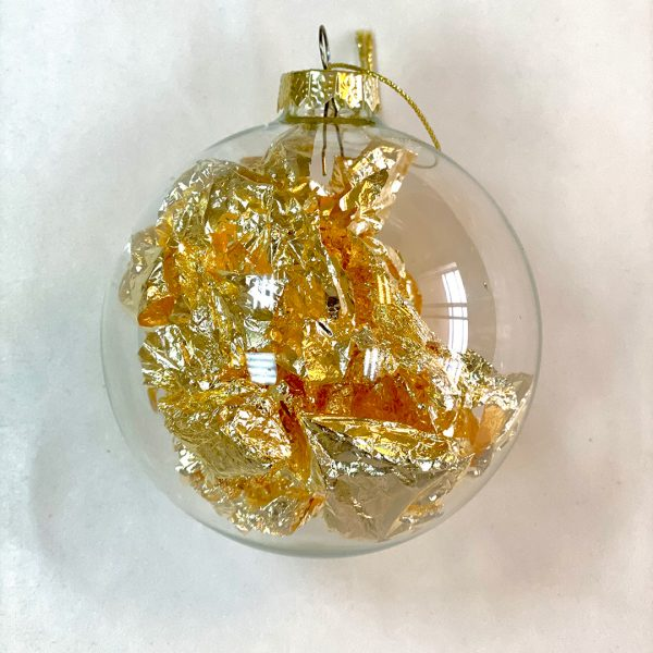 Christmas ball filled with gold skin