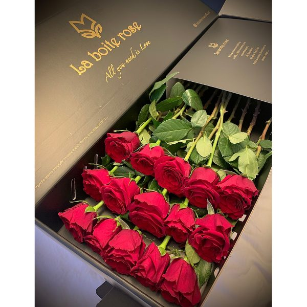 a bed of 15 roses in a black box for valentine
